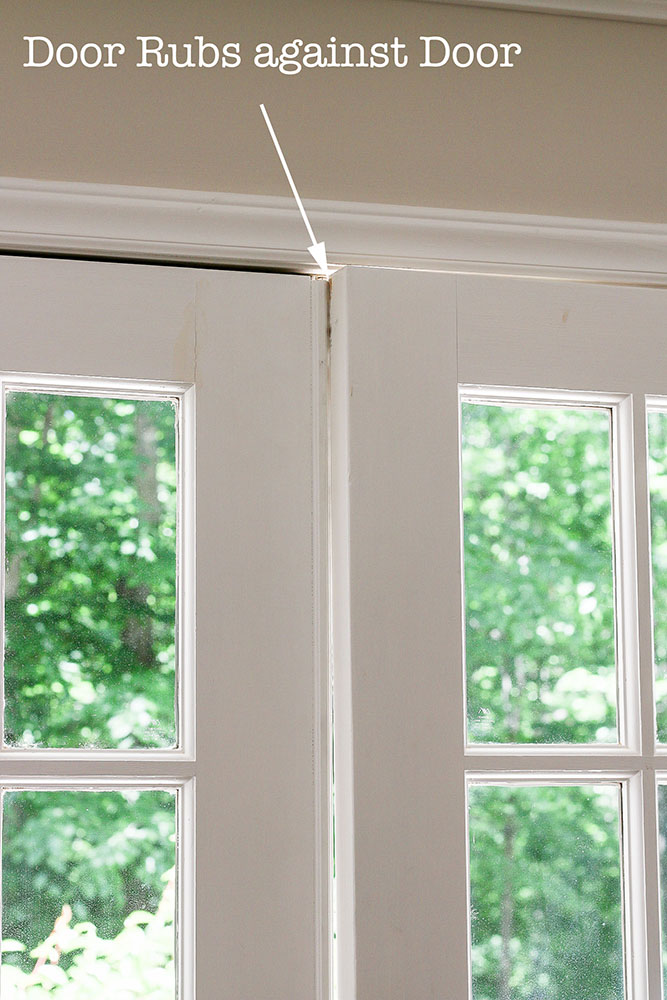 french doors rubbing at top