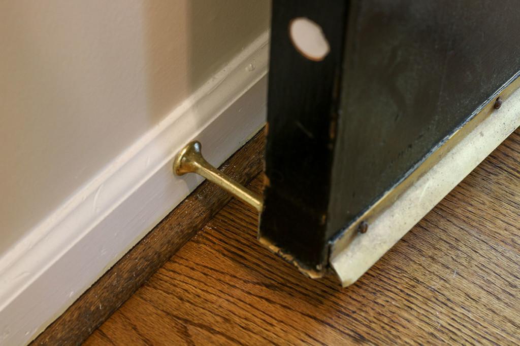 door stop behind door at baseboard