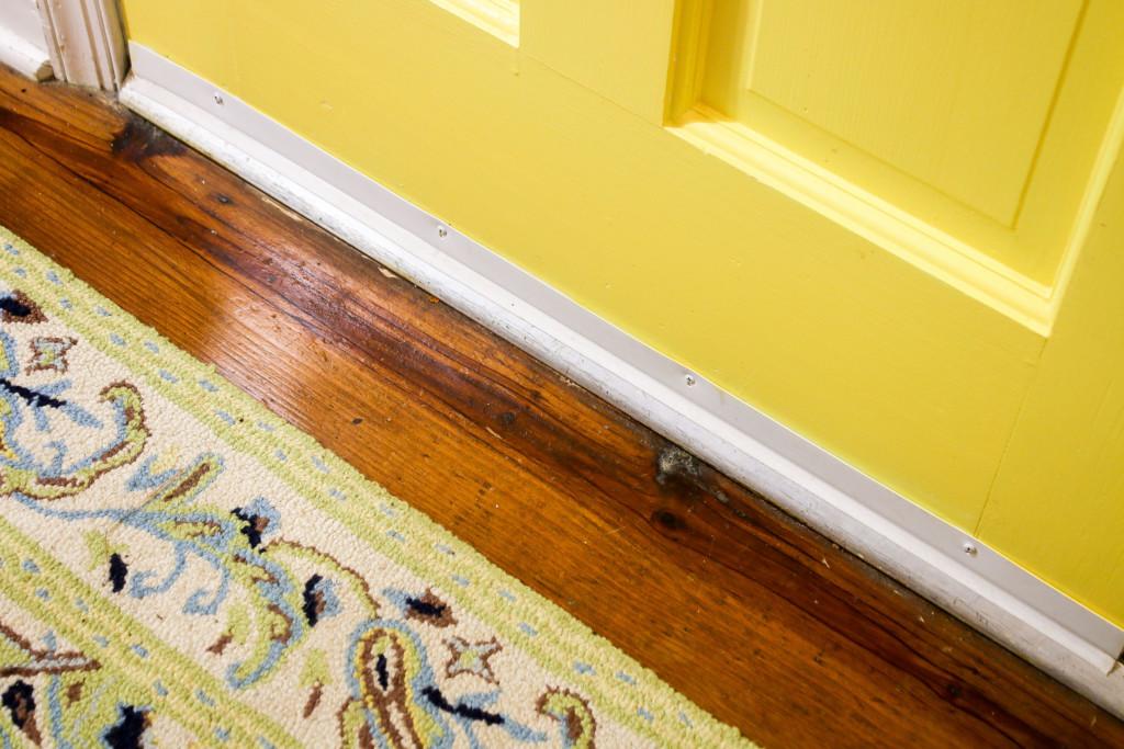white door sweep on yellow door