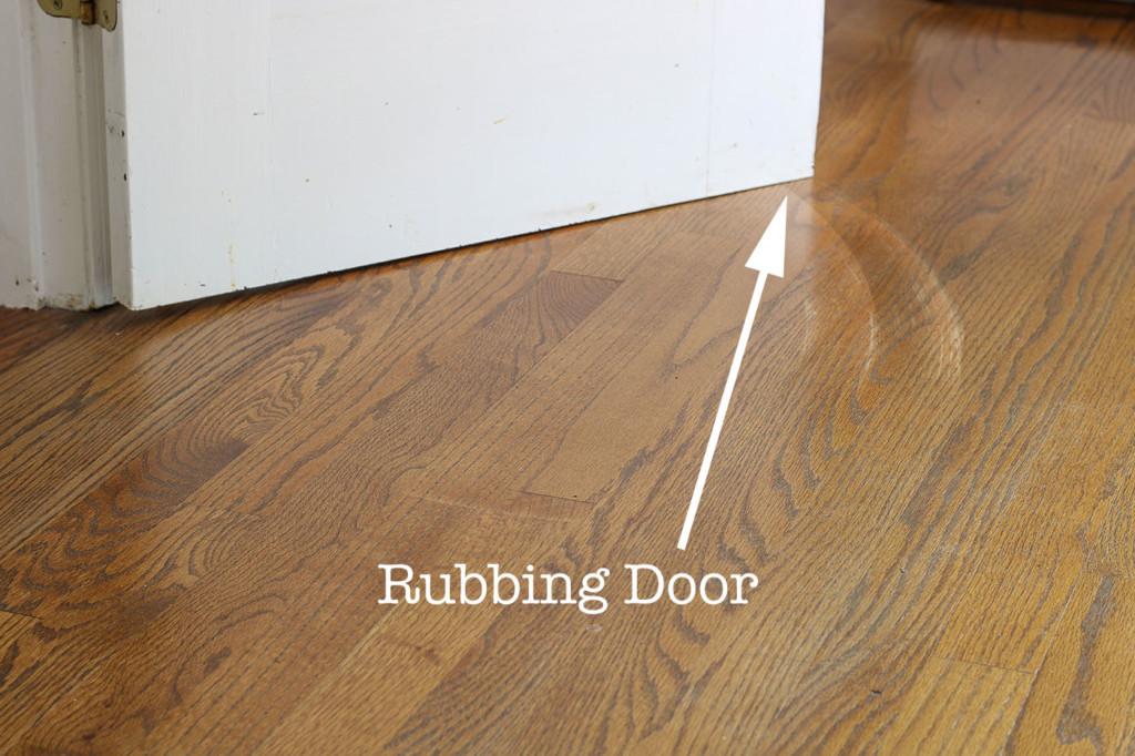 door scraping floor