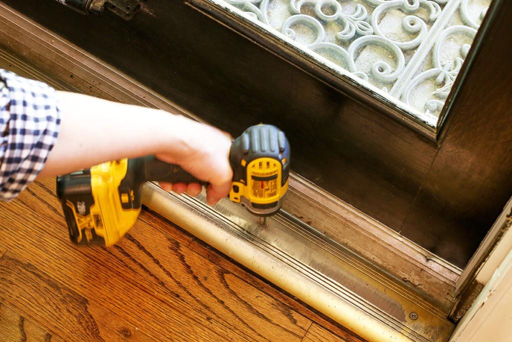 driving screws into door threshold