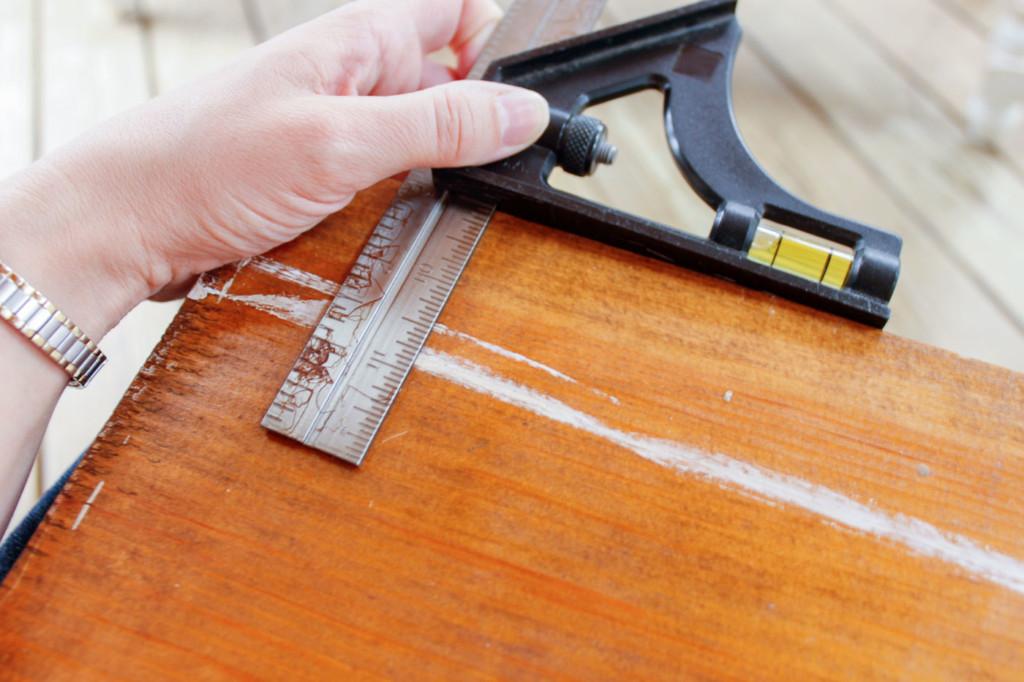 using carpenter square to measure depth of shelves