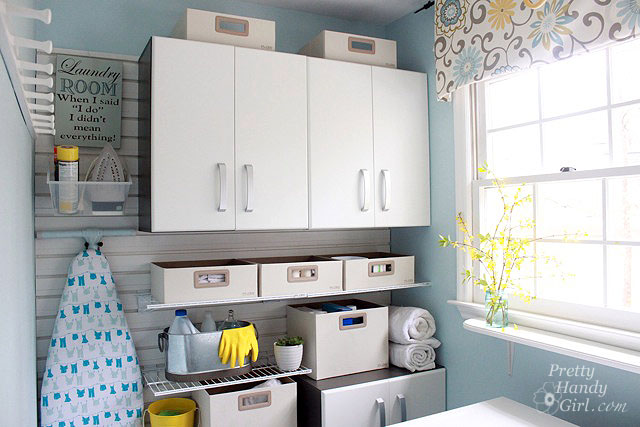 upgrade laundry room with flow wall cabinets and slat wall