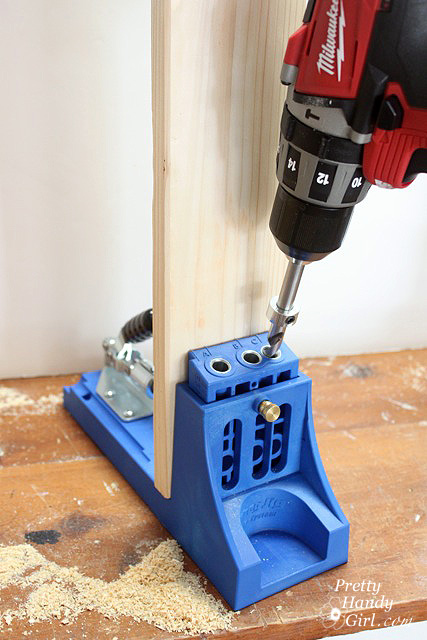 Remove the drill bit and unclamp the wood.