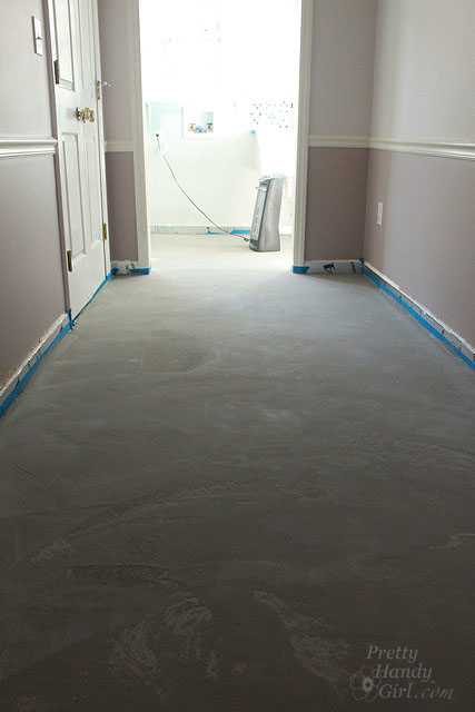 How to patch and level a concrete subfloor pretty handy girl let the leveling liquid dry overnight before walking on it the self leveling liquid will dry lighter and to a matte finish solutioingenieria Choice Image
