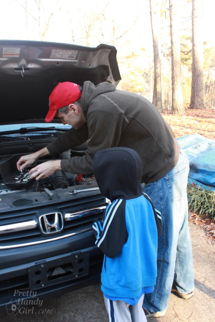 working_on_car_with_little_helper