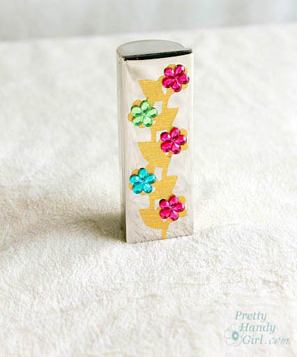 single_gold_leaf_flower_lipstick_case