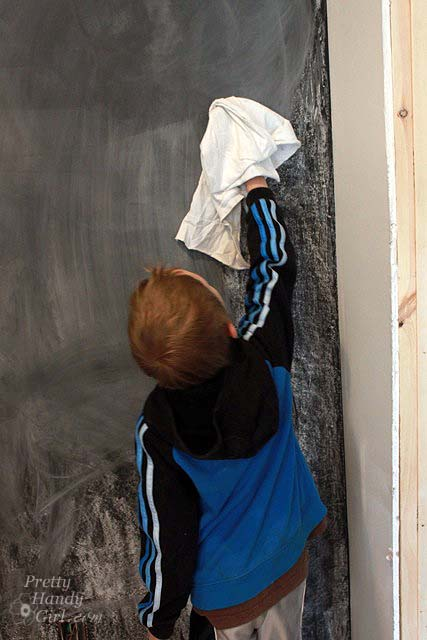 child_wiping_chalkboard