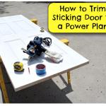 Trim a door with a power planer