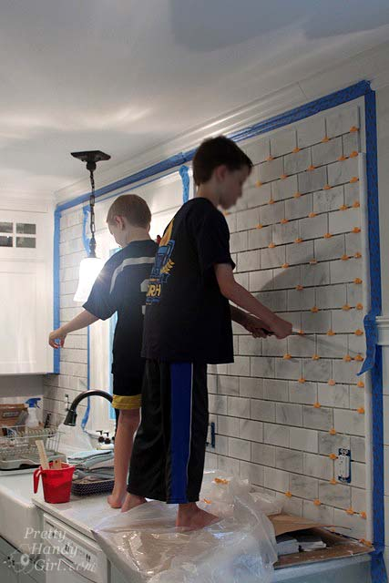 children_helping_tiles