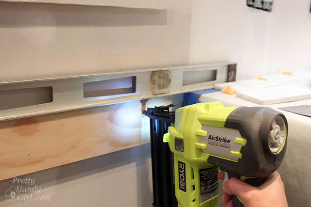 Attach support board to wall with Ryobi Finish Nailer