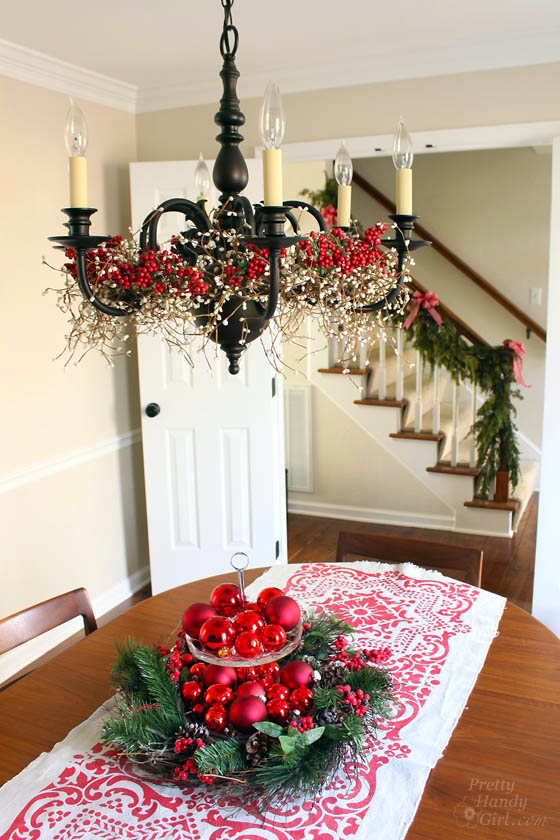 Clever holiday decor - garlands in chandelier