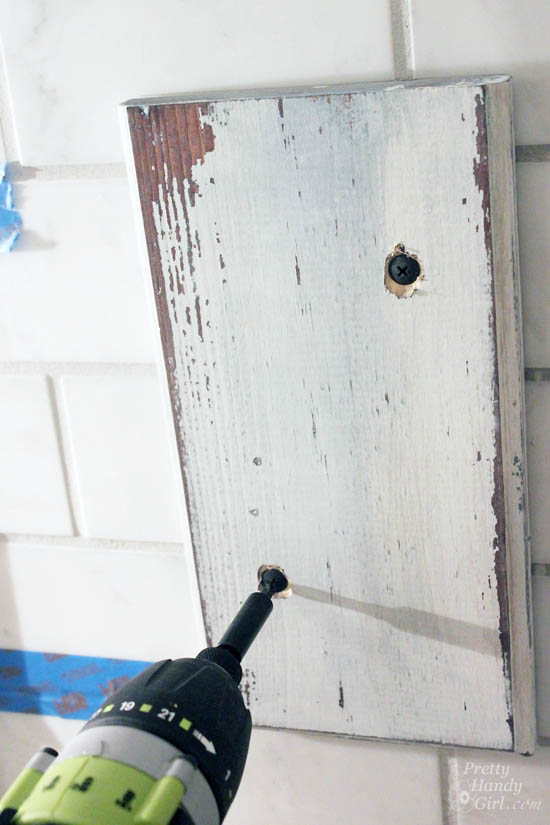 drive-screws-into-support-plaque