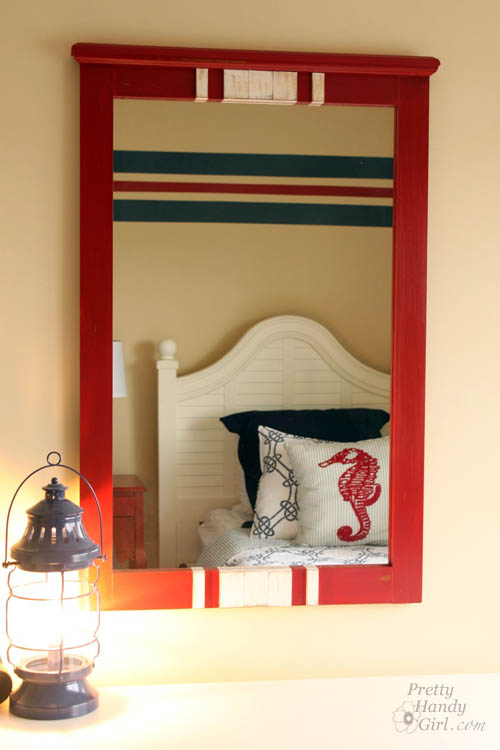 Some red milk paint, lattice and glue transform this $15 find into a charming racing stripe mirror perfect for a boys' room! | thrift store makeover | DIY mirror | mirror tutorial | #prettyhandygirl #DIY #tutorial