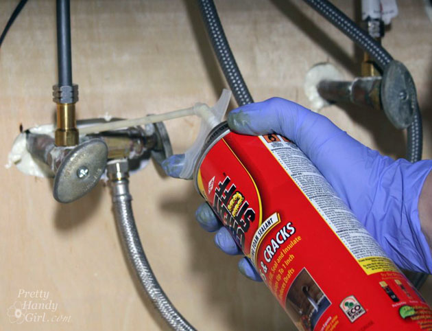 Seal Gaps Around Pipes with GREAT STUFF   Pretty Handy Girl