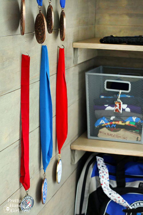 Sport Gear Storage Shelves in a Small Space | Pretty Handy Girl