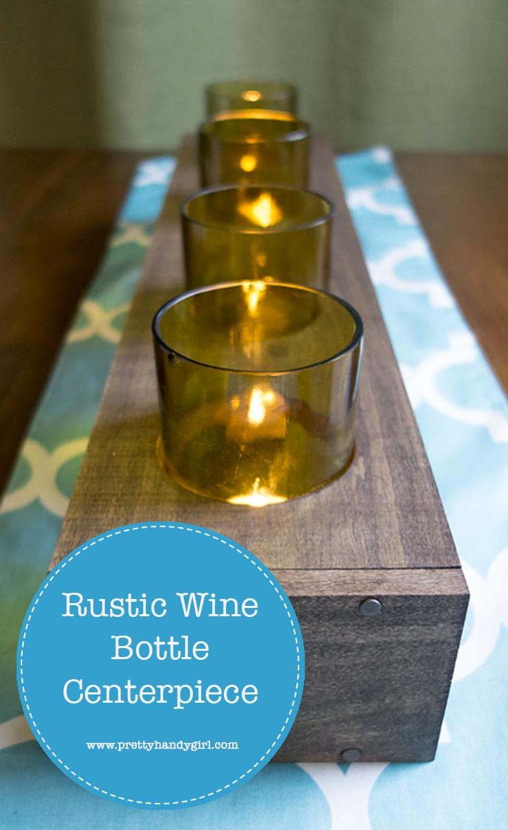 Easily upcycle old glasses with this DIY rustic wine bottle centerpiece from Pretty Handy Girl!   Upcycle project   rustic table centerpiece #prettyhandygirl #DIY #tabledecor