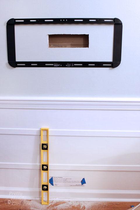 Installing a Wall Mount Flat Screen TV + Hiding Cords   PrettyHandyGirl