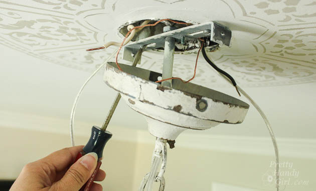 Attach the light fixture mounting bracket to your ceiling box. How to  Install a New Chandelier | Pretty Handy Girl - How To Install A Chandelier