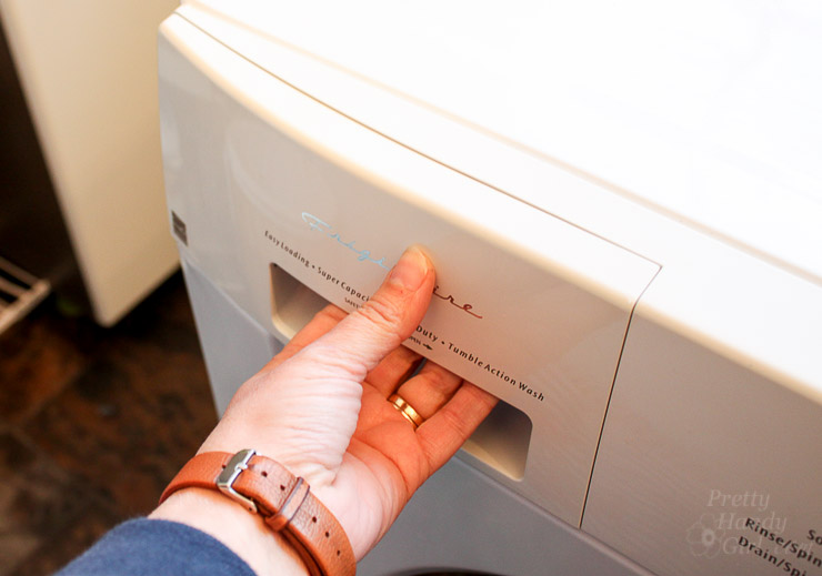 Pulling Out detergent drawer on clothes washer