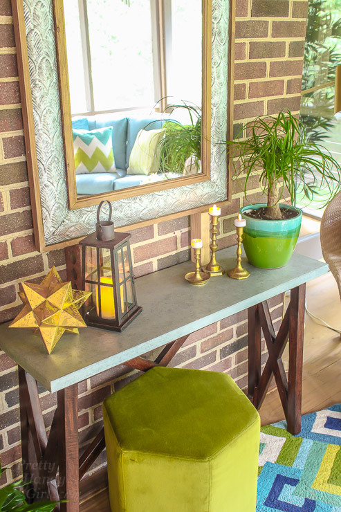 This Drab Screen Porch got a major Makeover with pops of Aqua and Green! Yummy Color!