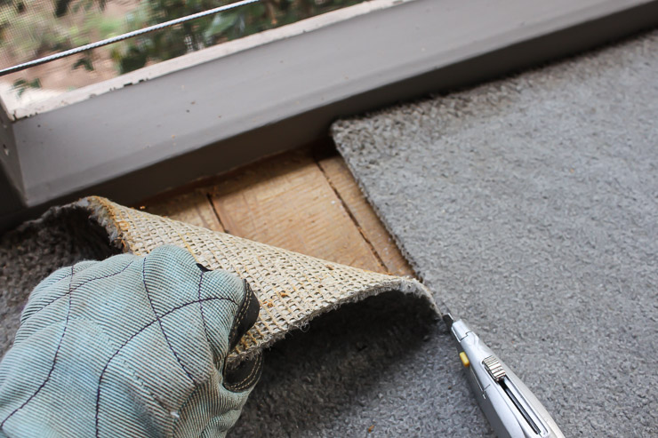 cutting-old-carpet-out-utility-knife