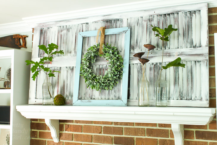 Old Shutters as backdrop on mantel