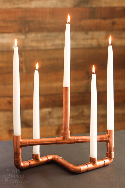 copper-pipe-centerpiece-candleabra-lit-2