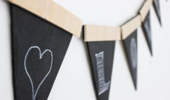 Love this twist on the traditional party banners! This rustic wooden version can be used again and again.