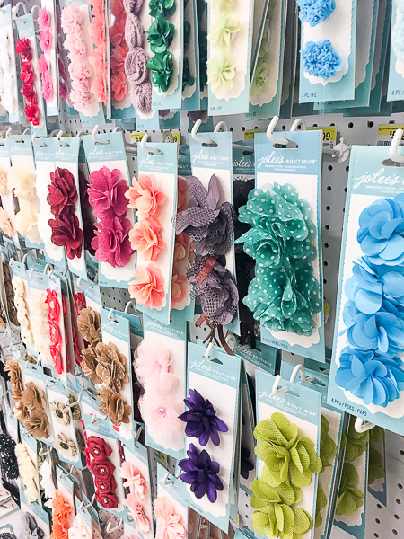 The scrapbooking aisle is the perfect place to look for things to decorate your curtain tie backs.