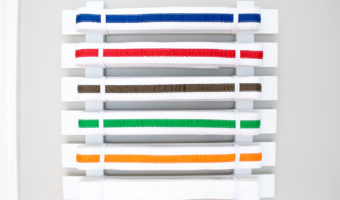 This simple karate belt display is easy to make and customize to any number of belts.