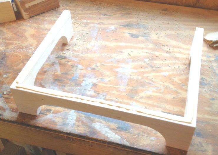 Add glue along edges of leg assembly