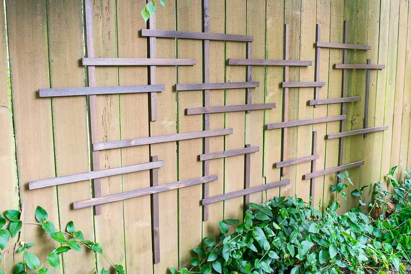 This fence trellis provides visual interest in winter, and a spot for climbing vines in the summer!