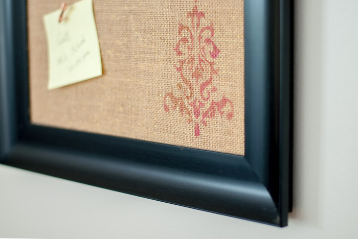 Adding stencils on burlap covered bulletin board