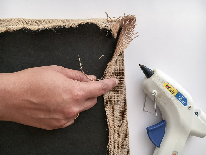 Attach burlap on rok to make a burlap covered bulletin board