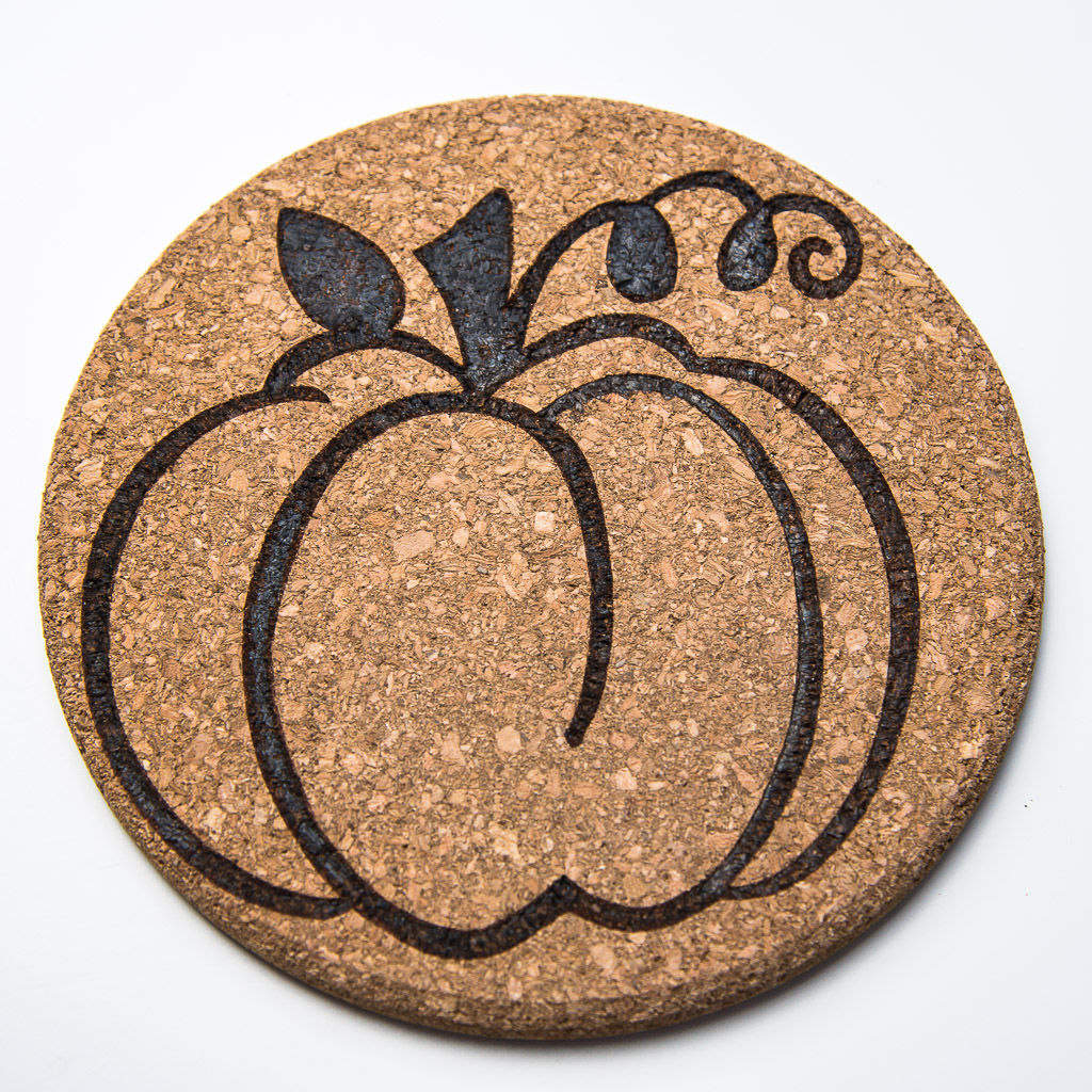 This pumpkin cork trivet is perfect for both Halloween and Thanksgiving themes!