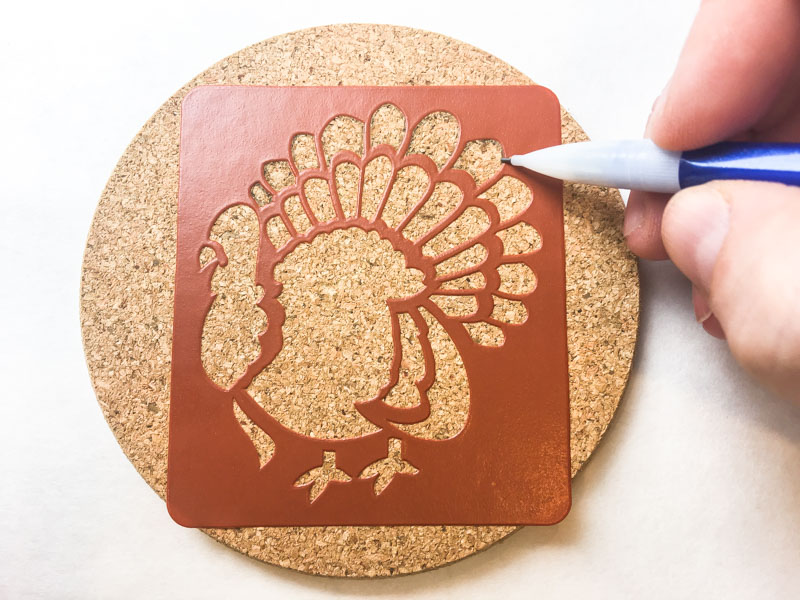 Trace around the edge of the stencil onto your cork trivets or coasters.