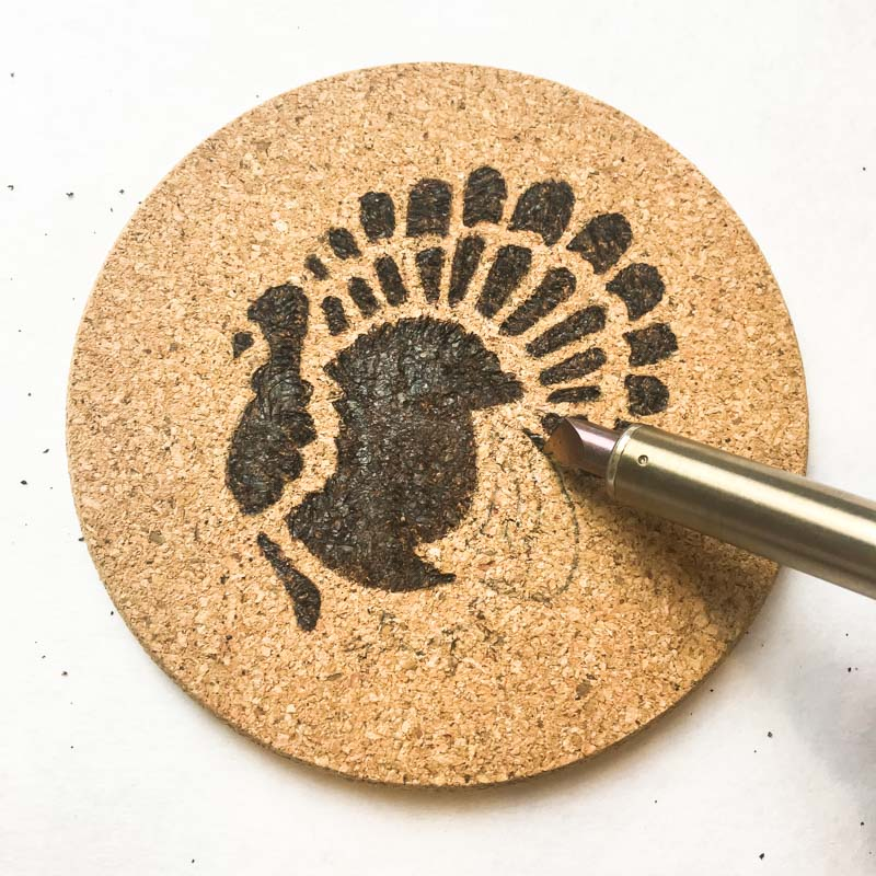 Outline the edge of larger areas with the tip of the woodburning tool.