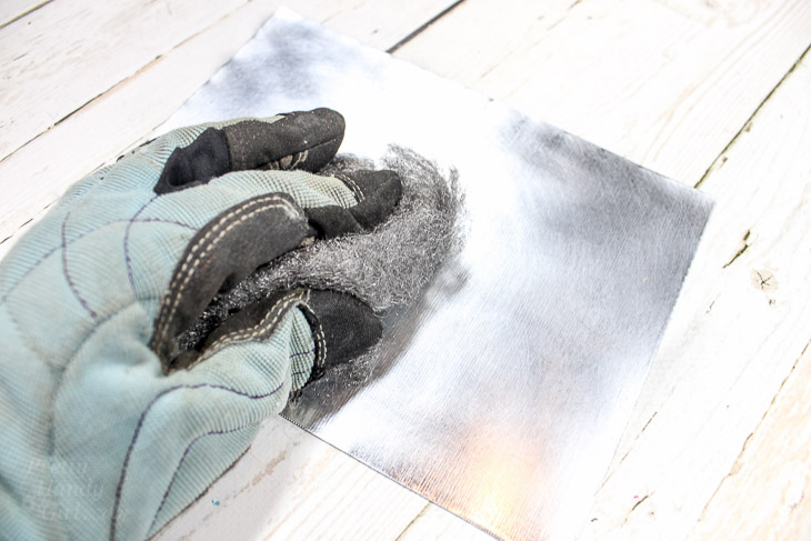 4. Use steel wool to dull sheet metal surface.