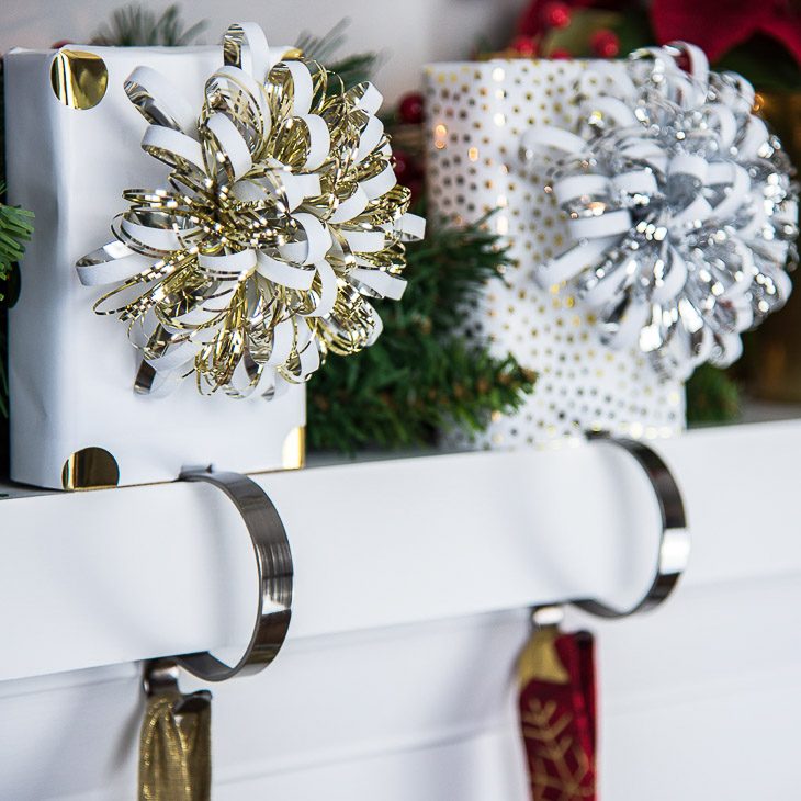 Decorate your mantel for Christmas with these DIY stocking holders made of scrap wood!