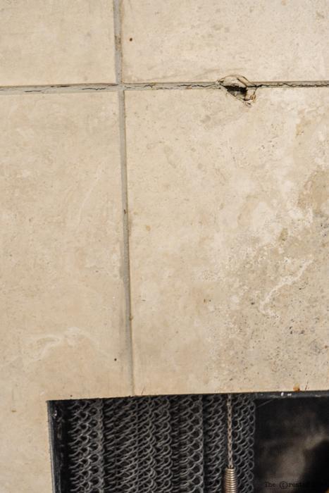 damaged tile fireplace