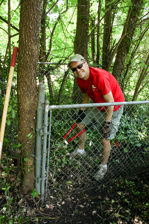 Mike, cutting the gate free of ivy