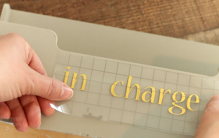 "Add vinyl lettering ""in charge"""