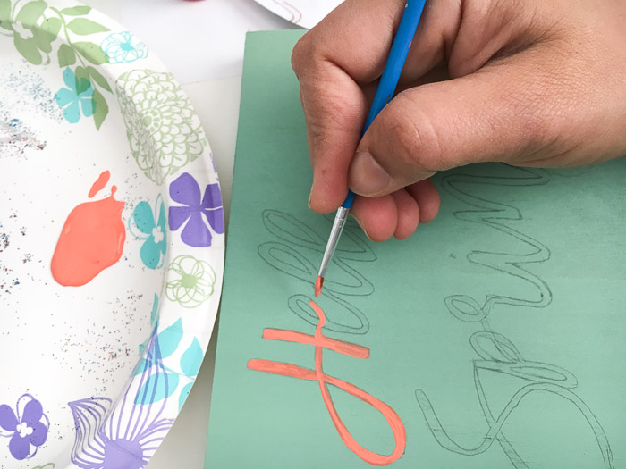 Painting a Hello spring sign