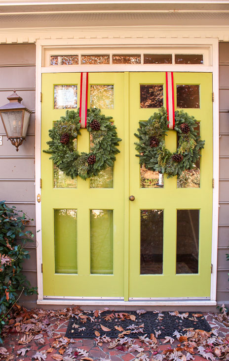 double lime green front door with Christmas wreaths