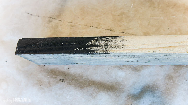painting wood slats with black paint