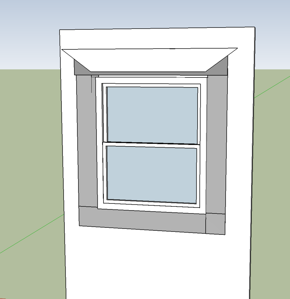 Flap of house wrap overlaps top of window flashing.