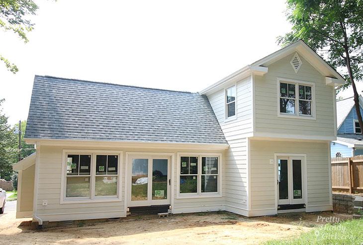 Plygem Mira doors and windows on cream house