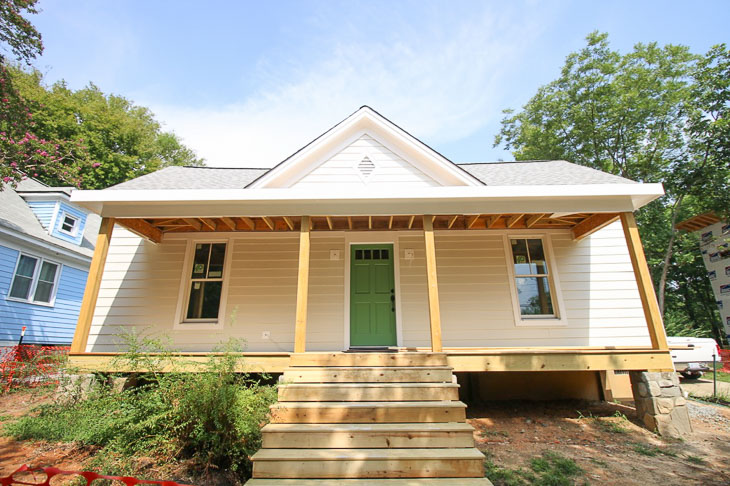 Off white farmhouse exterior house color, green door