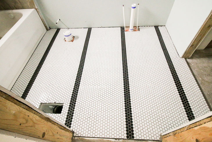 Jeffrey Court Small White and Black hex tiles in bathroom